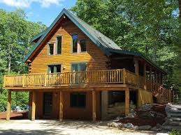 house porch side view beautiful log home in suissevale on lake homeaway moultonborough