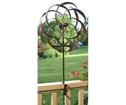bring color and motion to your yard with wind spinners in all