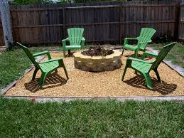 patio small backyard fire pits with green chairs around wooden