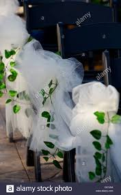 outdoor wedding decorations white tulle bows with green ivy on