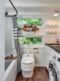tiny houses on foundations love this bathroom laundry combo and the hanging flowers i
