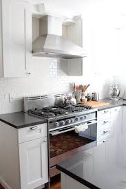 white kitchen with silestone quartz marengo countertops and martha