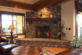 living room craftsman living room with wood stone fireplace