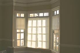 exquisite large bay window nuance with soft cloth draperies and