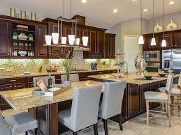traditional kitchen with undermount sink l shaped breakfast bar