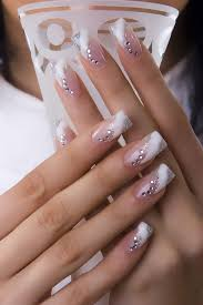 french tip nails with diamonds in curved and striped shape