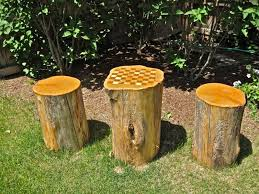 Outdoor Checker Table Made From Tree Stump Checker Board Table Grounded In The Garden