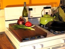 stove chop a stove top cutting board 69 via etsy good idea for