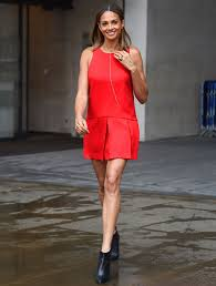 alesha dixon puts on a very leggy display in a tiny red dress as