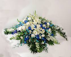 casket flowers blue orchids casket spray any time flowers