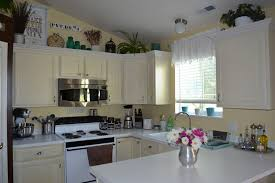 Above Kitchen Cabinet Decorations Top Of Kitchen Cabinet Decor Kitchen