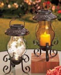 metal lantern patio lights cast a soft glow around your patio after dark with this solar garden