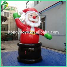 M M Inflatable Christmas Decorations by Inflatable Surfing Santa Claus Inflatable Surfing Santa Claus
