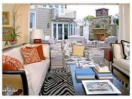 patterned sofa beach striped rug white wall cape cod coastal decor