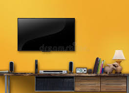 yellow livingroom led tv wooden table with yellow wall in livingroom stock photo