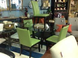 glass top dining table with 4 green leather chairs consignment
