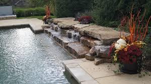 des peres outdoor kitchen with pool renovation poynter