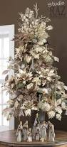 white christmas tree decorated with light gold silk poinsettias