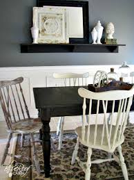 black table white chairs blue roof cabin custom dark stained farm table