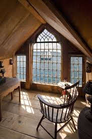 superb country attic bedroom with antique wooden curved arm rest superb country attic bedroom with antique wooden curved arm rest chair on woodn floors and open views wide glass windowed with blue ocean views