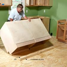 how to install kitchen island cabinets how to install cabinets like a pro kitchens woodworking and house