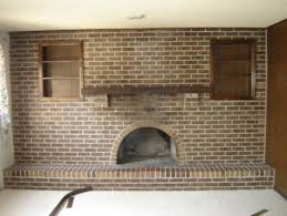 How To Cover Brick Fireplace by What To Do With A Full Wall Of Brick On A 1970s Fireplace In The