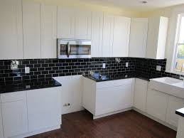 modern black and white kitchen backsplash tile diy wide plank butcher block countertops built in