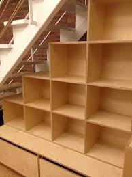 Tiered Bookshelves by Tiered Shelving Transforms A Staircase
