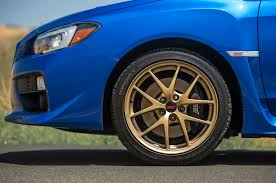 blue subaru gold rims 2015 subaru wrx sti launch edition long term update 1 motor trend