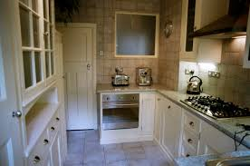 classy white fitted kitchen come with white wooden kitchen