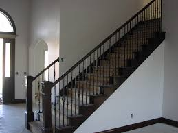 brick work complete stair railing installed and trim in basement