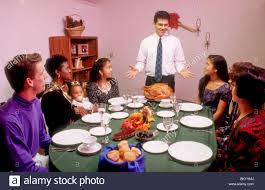 mixed race celebrates thanksgiving dinner meal