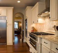 colonial gold granite and tumbled travertine backsplash home