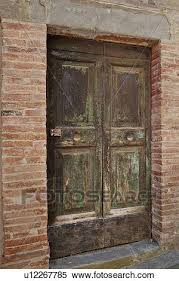 stock image of ancient wooden panelled door with peeling and