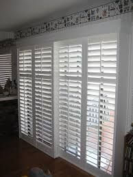 Plantation Shutters On Sliding Patio Doors White Faux Wood Plantation Sliding Door Shutters With White Wooden