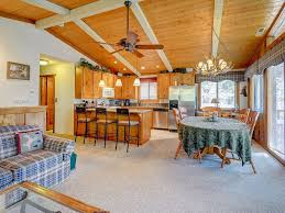 inviting two story cabin with a lovely deck close to ski slopes