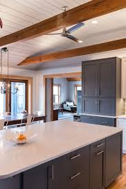 mix match a rustic house gets a modern updatec ville weekly two different colors of cabinets paired with two different styles of quartz countertops might seem like
