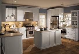 pretty white shaker kitchen cabinets dark wood floors kitchen with