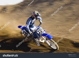 z racing motocross track young motocross racer riding motorcycle on stock photo 150369521