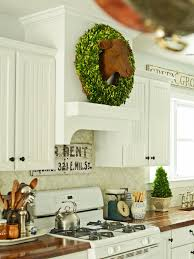 decor white wooden custom range hoods with wreath for kitchen