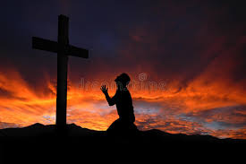 silhouette of praying to a cross with heavenly cloudscape su