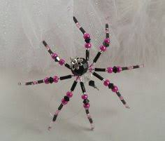 teal beaded spider ornament with spider legend