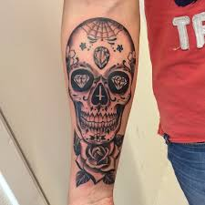 and sugar skull on forearm