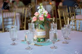 diy wedding decor table centerpieces with wine bottles wrapped