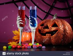 halloween background with purple happy halloween ghoulish party cocktail drinks with spider web and