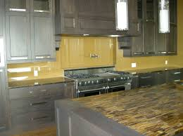 clear glass backsplash for kitchen with beautiful wooden cabinets