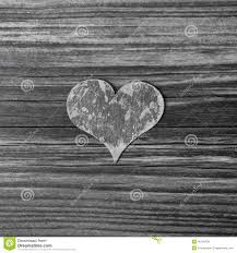 one grey wooden heart on shabby chic background stock photo