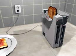 Buttered Bread In Toaster The Future Home 5 Toasters Straight From The Jetsons Brit Co