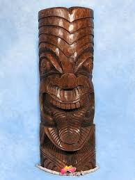 here is a thick hand carved tiki depicting a maori deity with its