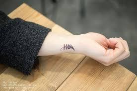 fern leave on the left inner wrist